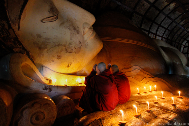 Places to see in Myanmar: Monks praying at the Shwethalyaung Reclining Buddha