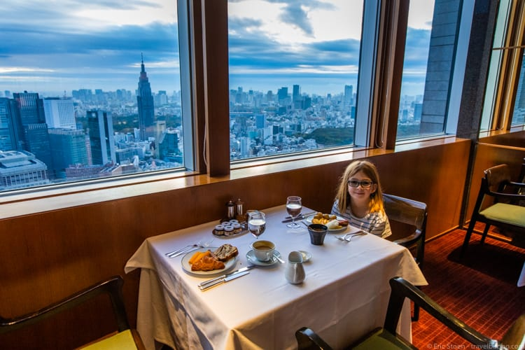 Jet Lag Tips - Every single morning at the Park Hyatt Tokyo my daughter and I are the first to arrive. So we choose the table with the best view, and we polish off the entire plate of mango!